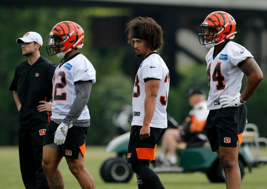 Cincinnati Bengals halfback Rodney Anderson (33) watches drills as he walks though in a knee brace during a rookie mini camp practice at the Paul Brown Stadium practice field in downtown Cincinnati on Friday, May 10, 2019.