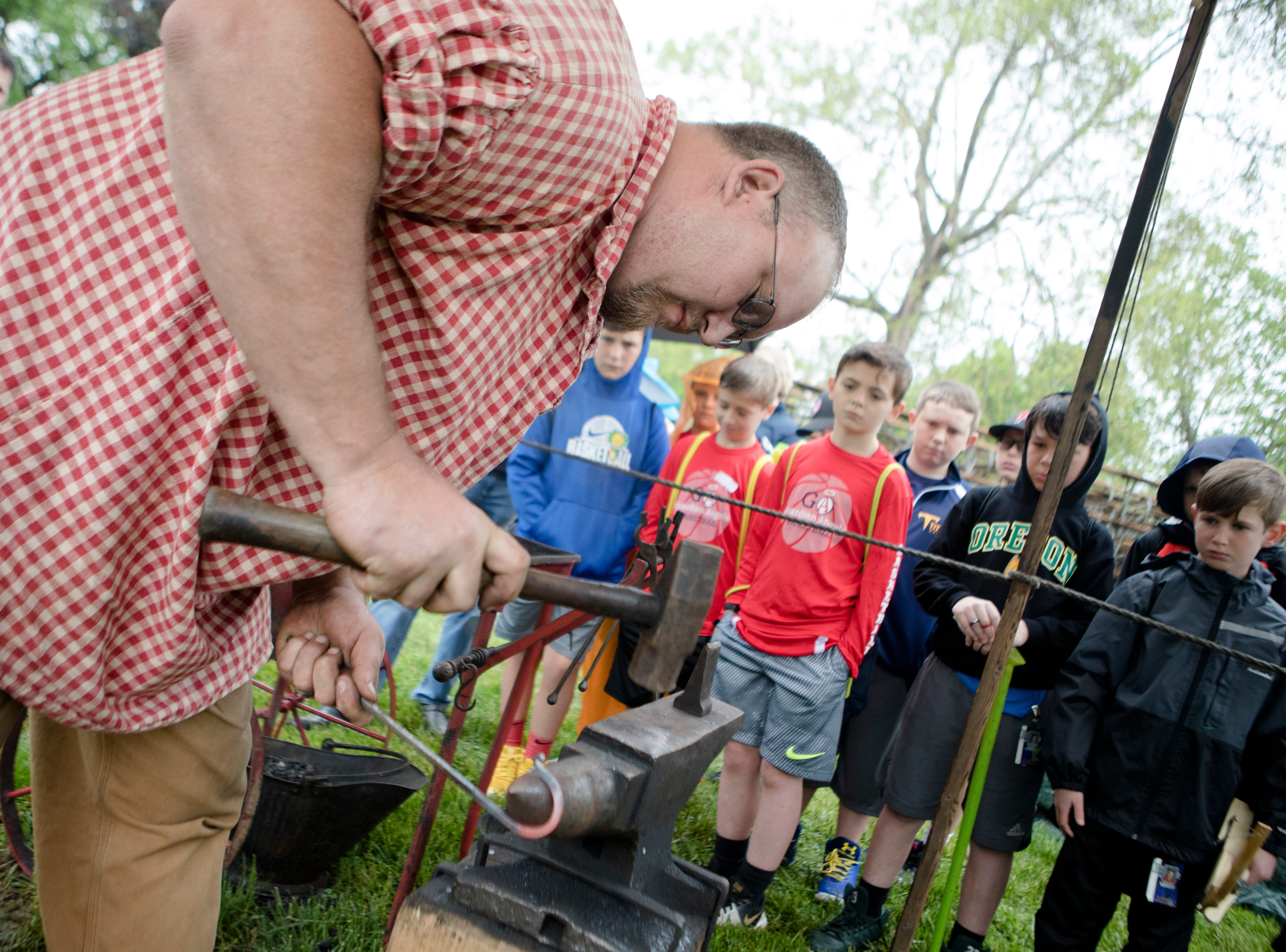 Dustin Baker, of Tipp City, teaches onlookers how to creates an S tie with hand tools during the 50th annual Appalachian Festival on Friday, May 10, 2019, At Coney Island in Cincinnati.