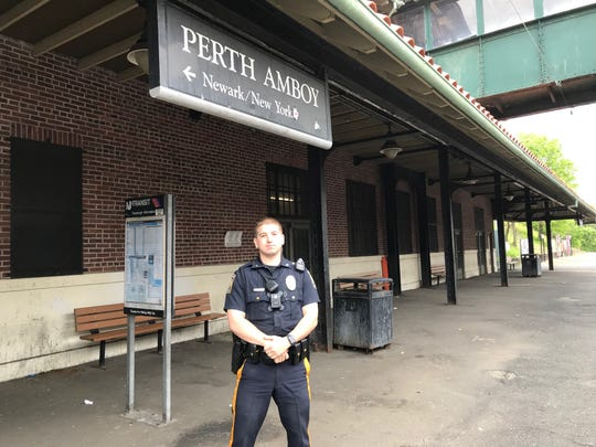 Perth Amboy Police Officer Kyle Savoia on the platform at the Perth Amboy Train Station