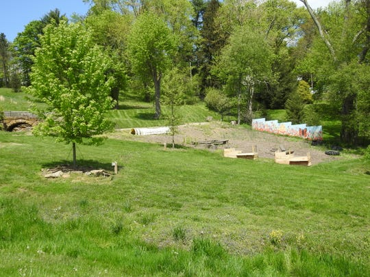 Land near the children's garden at Clary Gardens will have a new tent pad area for events by the end of July.