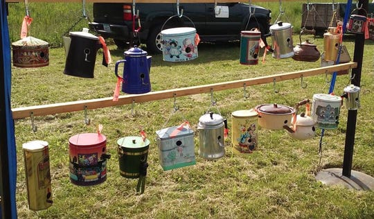 Household containers and coffee pots get a new lease on life as bird houses at the Indianola Rustiqueiowa flea market.