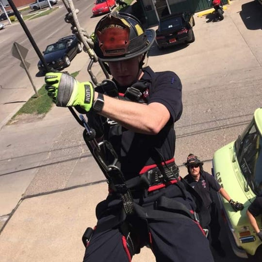Clinton firefighter Adam Cain shown during a training exercise. Cain was badly injured Jan. 5 in an explosion at a grain plant that killed Clinton fire Lt. Eric Hosette.