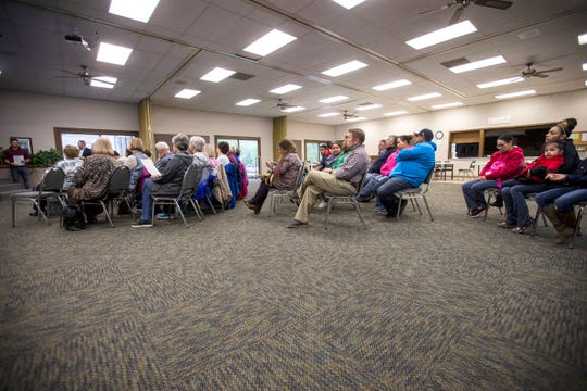 People listen during an event organized by Iowa WINS with the immigrant community, Thursday, May 9, 2019, at First Presbyterian Church in Mount Pleasant, Iowa.