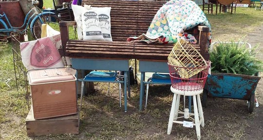 Keep your eyes open at Indianola's Rustiqueiowa flea market. Do you see the two school desks beneath the hanging swing?