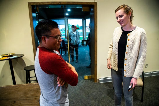 Nicole Novak, right, talks with Francisco Tojin, 33, of Guatemala after an event organized by Iowa WINS with the immigrant community, Thursday, May 9, 2019, at First Presbyterian Church in Mount Pleasant, Iowa. Novak is an assistant research scientist with the University of Iowa College of Public Health.