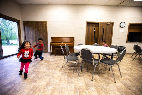 Children run around past tables during an event organized by Iowa WINS with the immigrant community, Thursday, May 9, 2019, at First Presbyterian Church in Mount Pleasant, Iowa.