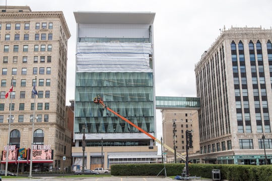Little Caesars new headquarters office, center, between the Fillmore Detroit, left, and the Fox Theatre in downtown Detroit, Friday, May 10, 2019.