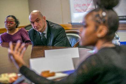 Superintendent Nikolai Vitti listens to students talk about their school concerns during the Student Leadership Development meeting at the Detroit Public Schools Community District headquarters in Detroit on Friday, May 10, 2019