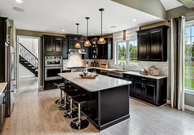 Dark Cabinets And Pops Of Color Are Trending In The Kitchen This Year