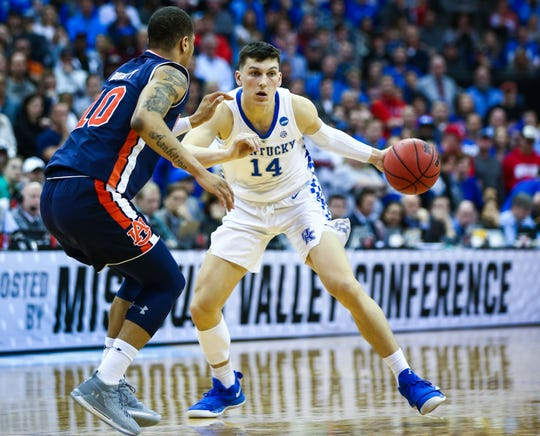 Tyler Herro dribbles against Auburn in the NCAA tournament.