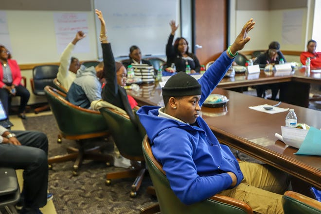 Students raise their hands to be called on by the Superintendent Nikolai Vitti to express their school concerns at the Student Leadership Development meeting at the Detroit Public Schools Community District headquarters in Detroit on Friday, May 10, 2019