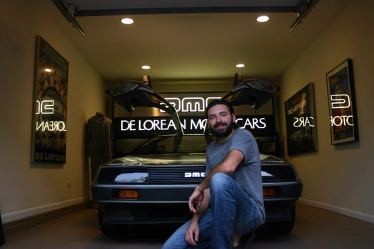 Producer Tamir Ardon of 'Framing John DeLorean' documentary in front of his DeLorean garage.