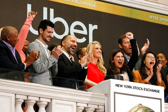 Uber CEO Dara Khosrowshahi, third from left, attends the opening bell ceremony at the New York Stock Exchange, as his company makes its initial public offering, Friday, May 10, 2019.
