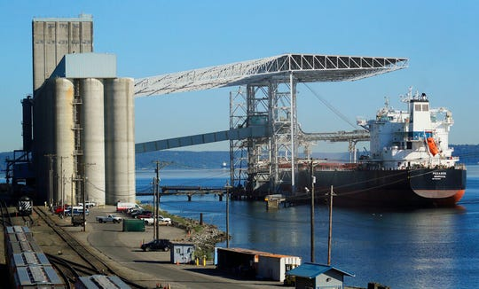 A bulk carrier ship is loaded, Friday, May 10, 2019, at the Temco grain terminal at the Port of Tacoma in Tacoma, Wash. U.S. and Chinese negotiators resumed trade talks Friday under increasing pressure after President Donald Trump raised tariffs on $200 billion in Chinese goods and Beijing promised to retaliate.