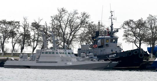 In this Monday, Nov. 26, 2018 file photo, three Ukrainian ships are docked in Kerch after the were seized by Russia. A U.N. court is considering a legal case brought by Ukraine over the capture of 24 sailors and three naval vessels held by Russia since November.