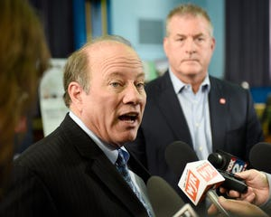 Mayor Mike Duggan, left, and David C. Dauch, AAM Chairman and Chief Executive Officer talk to reporters on Friday, May 10, 2019.