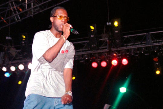 "In this April 12, 1997, file photo, Prakazrel ""Pras"" Michel, part of the group the Fugees, performs during a concert in Port-au-Prince, Haiti. A lawyer for Michel says his client is facing charges related to 2012 campaign contributions."