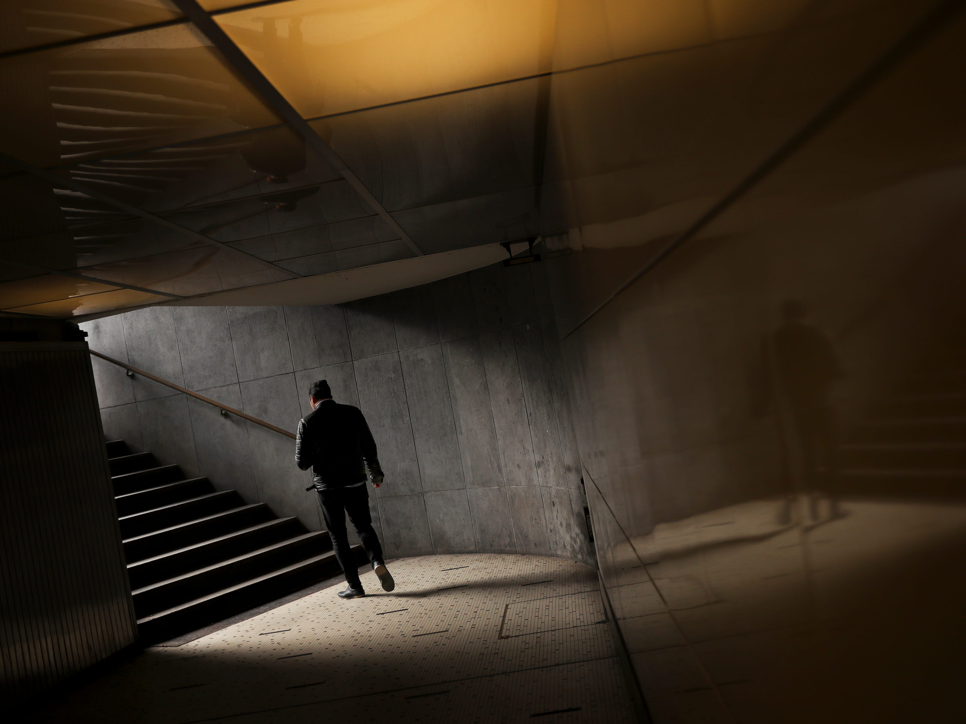 A man walks out from a passageway at the railway Central Station in Brussels, Friday, May 10, 2019.