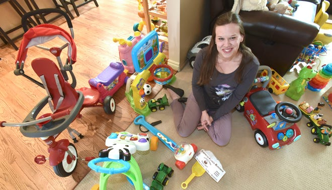 Samaritas-licensed foster parent Sarah Sporny poses among the toys of her son, Mikey, that she and her husband and Mikey's father, Robert, (neither pictured) will share with future foster children at their home in Farmington Hills.