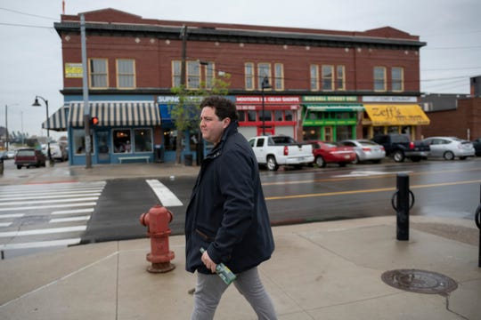 """People out there are saying I want to demolish everything,"" says developer Sanford Nelson, seen walking through Eastern Market."