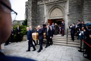 Pallbearers carry the casket of Red Kelly after the funeral mass at the Holy Rosary Roman Catholic Church in Toronto.