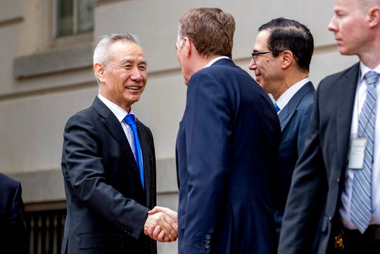 Treasury Secretary Steve Mnuchin, second from right, and United States Trade Representative Robert Lighthizer, second from left, greet Chinese Vice Premier Liu He as he arrives at the Office of the United States Trade Representative in Washington, Friday, May 10, 2019 for trade talks between the United States and China.