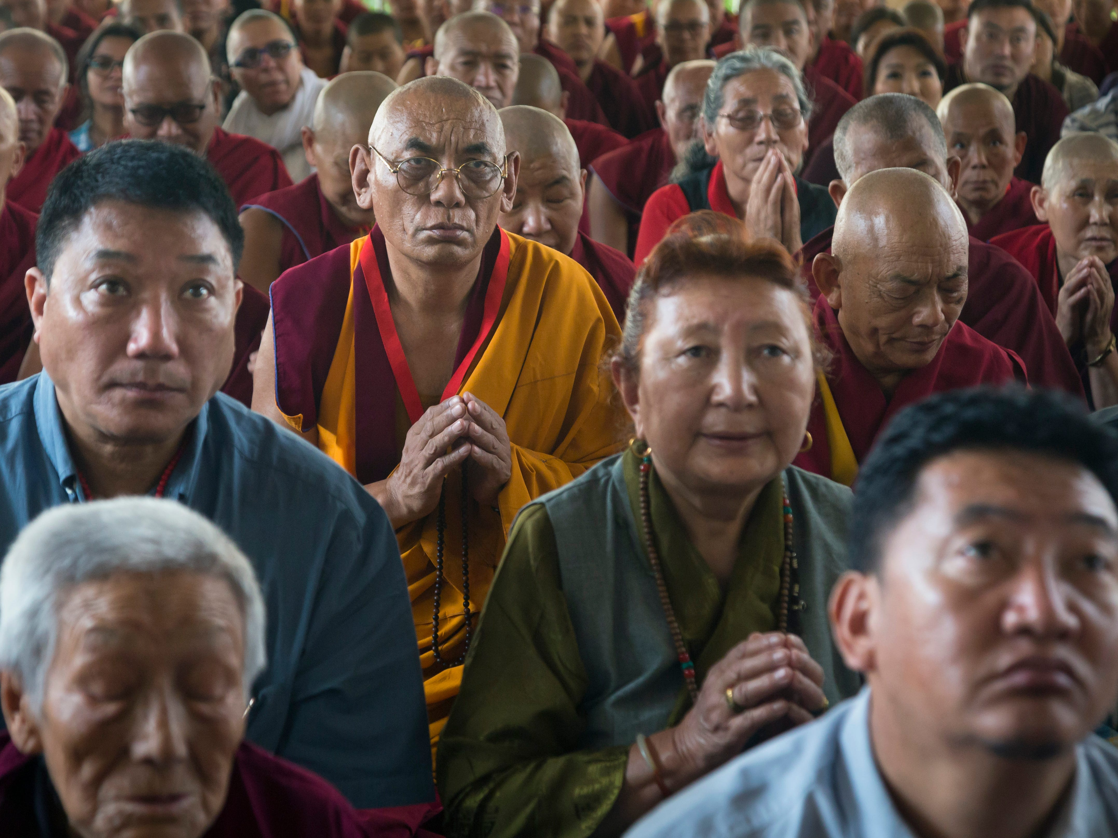 Exile Tibetans listen to their spiritual leader the Dalai Lama during a religious talk at the Tsuglakhang temple in Dharmsala, India, Friday, May 10, 2019. The Tibetan leader began the three-day talk at the request of a Buddhist group from Russia Friday.