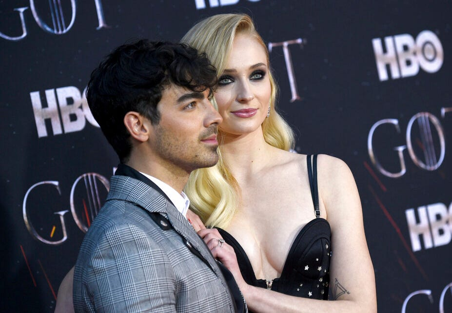 """In this April 3, 2019 file photo, Joe Jonas, left, and Sophie Turner attend HBO's """"Game of Thrones"""" final season premiere at Radio City Music Hall in New York. The couple have gotten married in a surprise ceremony in Las Vegas."""