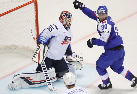 Slovakia's Tomas Tatar, a former Red Wing, celebrates his goal past goaltender Cory Schneider of the United States.