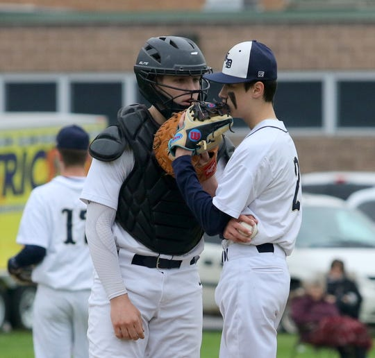 Elmira Notre Dame catcher Erik Charnetski talks to pitcher Owen Stewart during an IAC division tiebreaker between against Waverly on May 9, 2019 at Notre Dame High School.