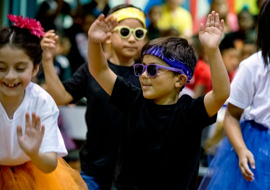 """First-grader Santino Rodas, center, dances with his peers to the Spanish Rock song """"Ahí Viene La Plaga"""" (""""Good Golly, Miss Molly"""") during Stockwell Elementary Schools annual International Day Celebration Friday, May 10, 2019."""