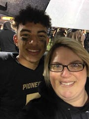 Devin Mockobee (left) with his mother, Rachel, after a football game