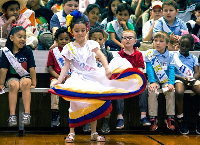 "Venezuela student representative, Valentina Urdaneta, dances to the Joropo song ""Alma Llanera"" (""Soul of the Plains"") during Stockwell Elementary Schools annual International Day Celebration Friday, May 10, 2019. The ""Alma Llanera"" (""Soul of the Plains"") song is considered Venezuela's unofficial second anthem."