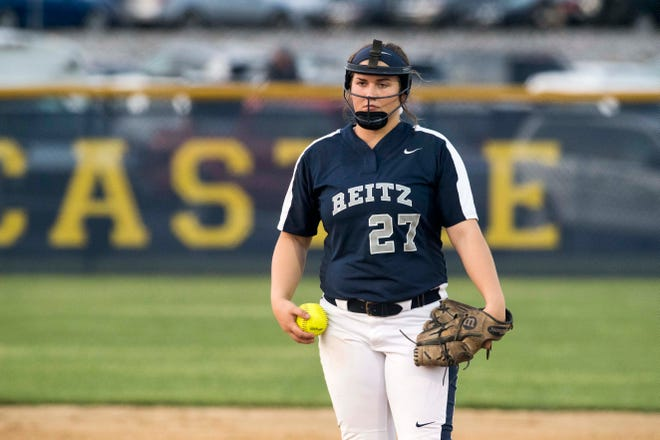 Reitz's Mikayla Jolly (27) reads the call from the catcher during the  Castle Knights vs. Reitz Panthers game at Lockyear Field in Newburgh, Ind. Thursday, May 10, 2019.