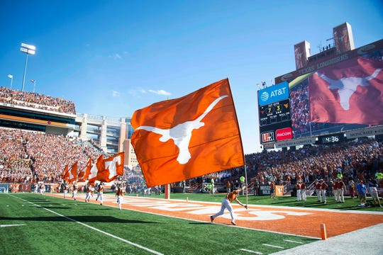 Nov 3, 2018; Austin, TX, USA; Texas Longhorns cheerleaders run flags down the field after the Texas Longhorns score a touchdown during the first quarter against the West Virginia Mountaineers at Darrell K Royal-Texas Memorial Stadium. Mandatory Credit: Bethany Hocker-USA TODAY Sports