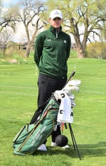 """CSU golfer A.J. Ott poses with the bag honoring U.S. Army 1st Lt. James """"Jerry"""" Jackson on Friday at the Harmony Club. Ott earned the right to carry the special bag honoring the late veteran of the Vietnam War in an NCAA Regional tournament Monday through Wednesday, May 13-15, 2019, in Pullman, Wash."""