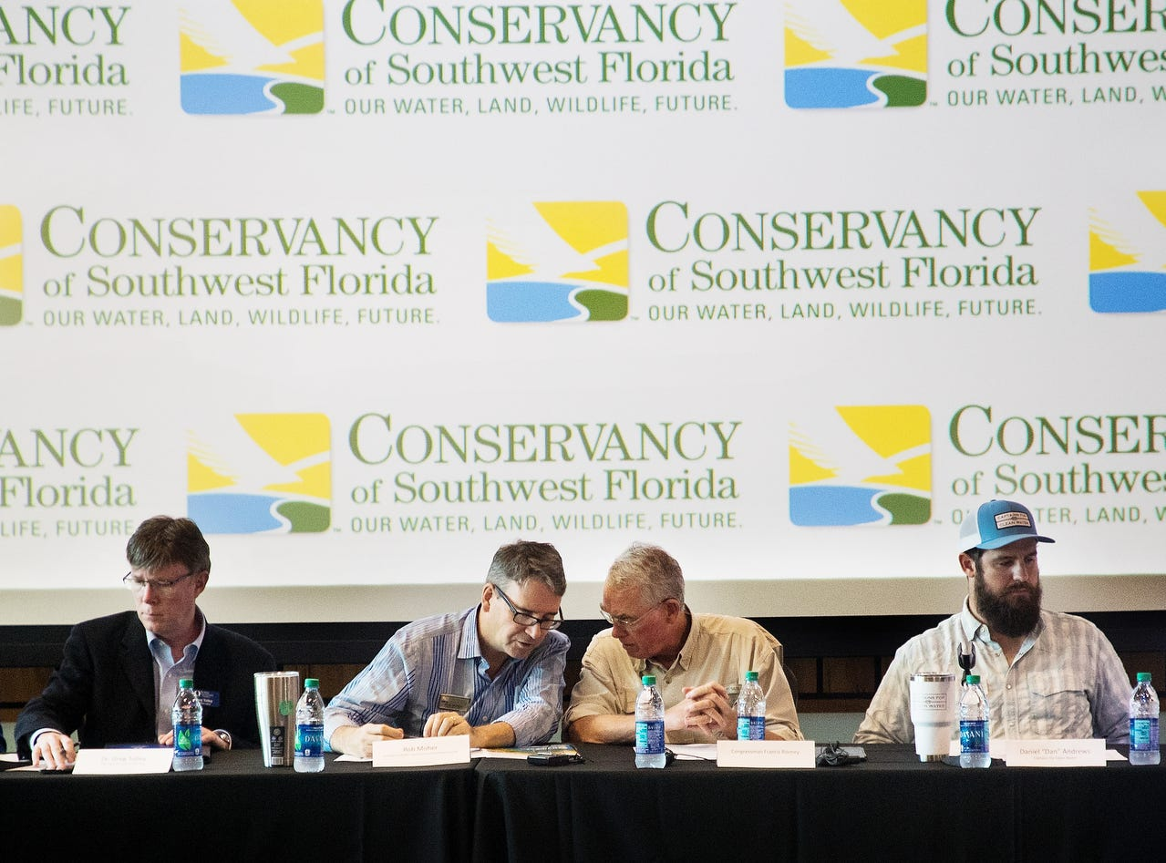 U.S Rep. Francis Rooney speaks with Rob Moher at public meeting about water quality issues at the Conservancy of Southwest Florida in Naples on Friday May 10, 2019. The meeting was held with water quality stakeholders and water quality advocates. Moher is the president of the Conservancy. On the left is Greg Tolley, Professor of Marine Science at FGCU. On the right is Capt. Daniel Andrews, founder of Captains for Clean Water.