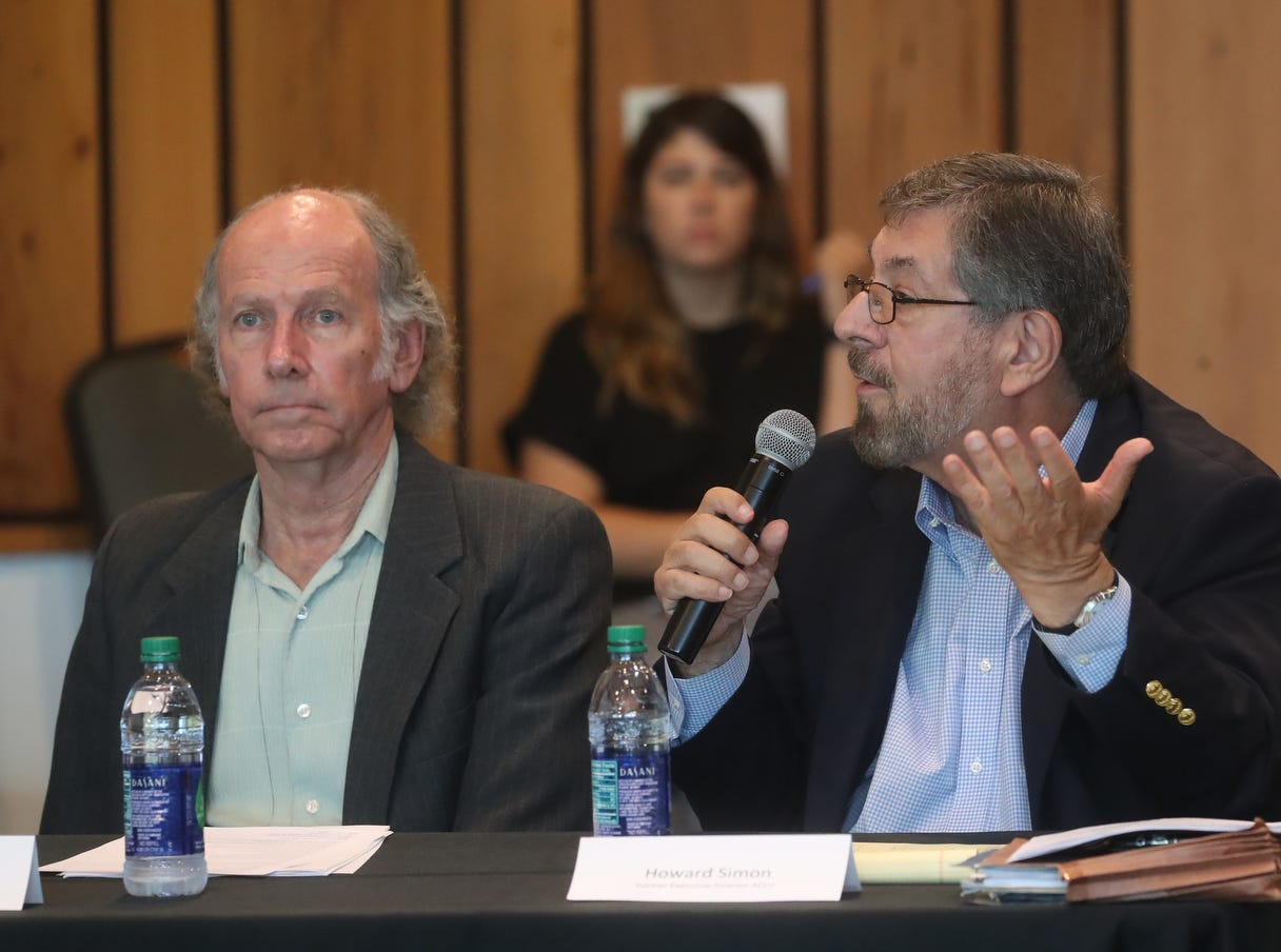 Howard Simon, right, addresses  U.S. Rep. Francis Rooney at a public meeting about water quality issues at the Conservancy of Southwest Florida in Naples on Friday May 10, 2019. U.S. Rep. Francis Rooney oversaw the meeting. On the left is Larry Brand, a professor of marine biology at the University of Miami