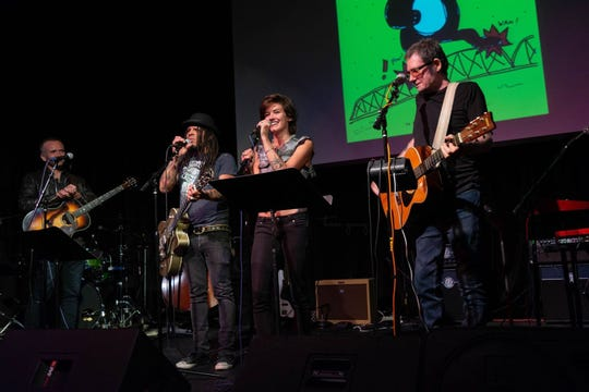 """Josh Harty, Eric McFadden, Morgan Rae and pat mAcdonald, from left, perform """"Long Way Gone"""" at Third Avenue Playhouse in Sturgeon Bay in one of the two showcase concerts of newly written songs during last year's Steel Bridge Songfest. Organizers mAcdonald and melaniejane made significant changes to this year's event to sharpen its focus on songwriting."""