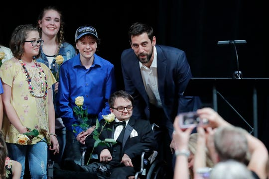 Green Bay Packers quarterback Aaron Rodgers takes photos with child cancer survivors at the Prevea Runway for Life - The Grande Finale, a fundraiser for Families of Children with Cancer Inc.,  at Jet Air on Thursday.