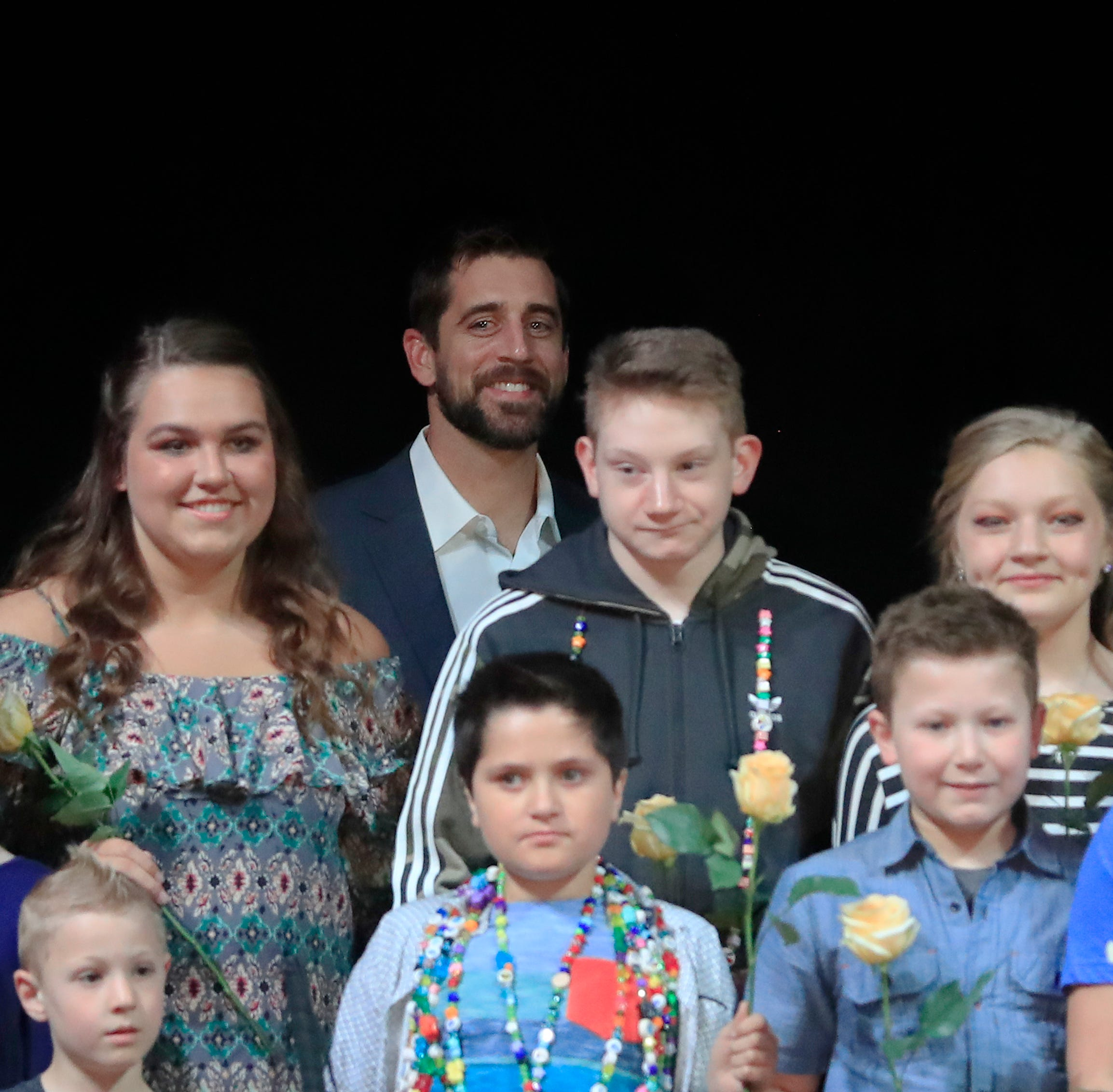 Aaron Rodgers surprises child cancer survivors on runway, signs jersey that raises $11,000