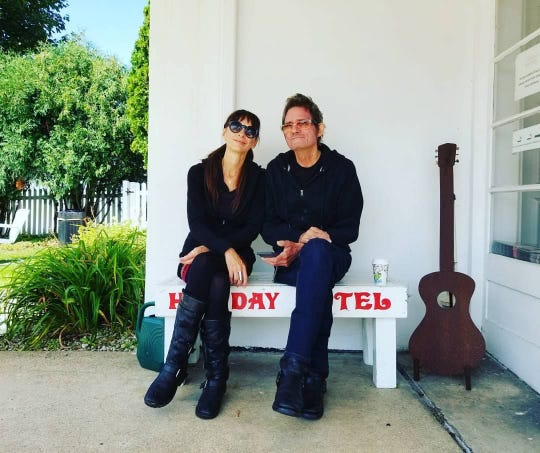 melaniejane and pat mAcdonald sit outside their Holiday Music Motel in Sturgeon Bay, where they organize and host the annual Steel Bridge Songfest songwriting collaborative each June.
