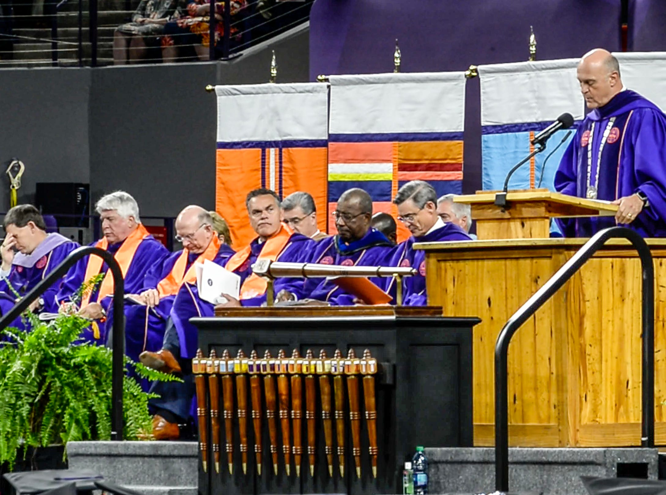 """Clemson President Jim Clements awards a degree in Enviromental and Natural Resources posthumously to William """"Billy"""" L. Gallien of Clover, S.C., during Clemson University commencement ceremonies in Littlejohn Coliseum in Clemson Friday, May 10, 2019. Gallien died after driving a 2006 Ford pickup truck May 1 into the rear of a dump truck that was stopped in one of the I-85 northbound lanes in Spartanburg County."""