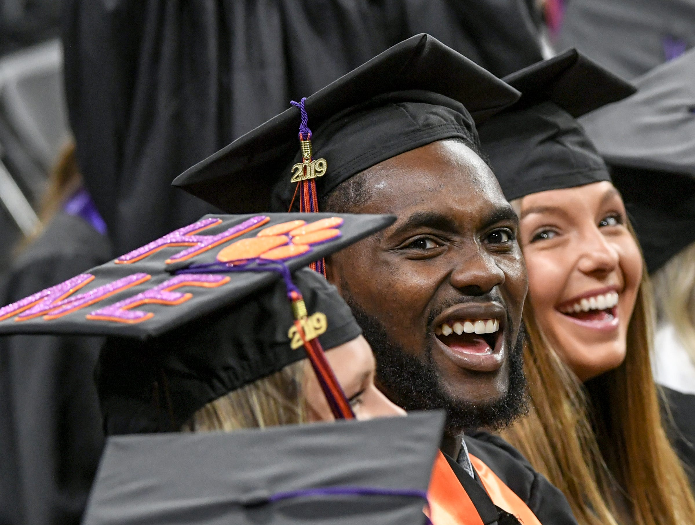 Elijah Thomas, a former men's basketball player who earned a bachelor of science in parks, recreation, tourism, management smiles during Clemson University commencement ceremonies in Littlejohn Coliseum in Clemson Friday, May 10, 2019.