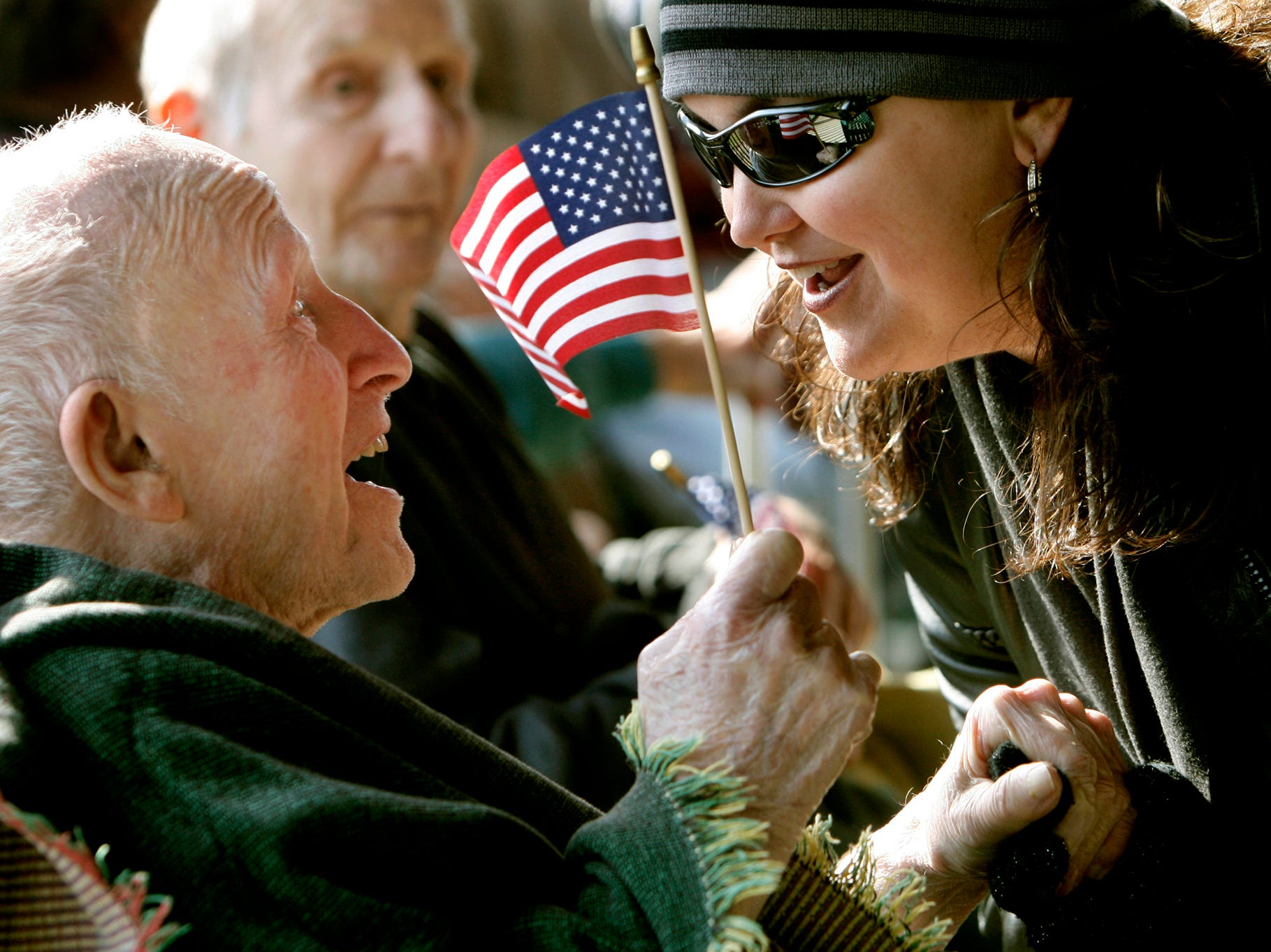 Shannon Junkins, right, of Anderson greets Frank Stone of Atlanta, Ga. Sunday at the Richard M. Campbell Veterans Nursing Home in Anderson.  Nearly 300 motorcycle riders started a ride from the Anderson County Veterans Monument to the veterans home to bring gifts the residents, as well as watching skydivers drop in as part of Veteran's Day in 2007.
