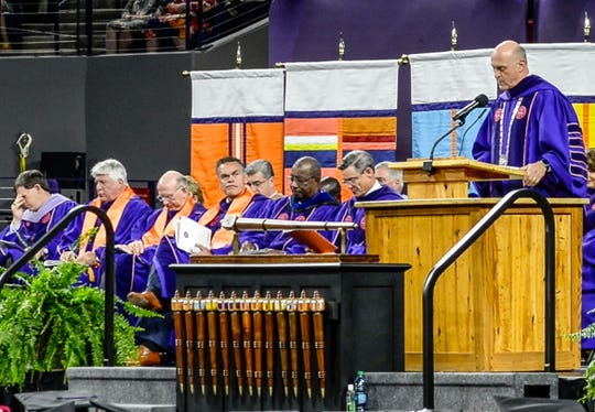 "Clemson President Jim Clements awards a degree in Enviromental and Natural Resources posthumously to William ""Billy"" L. Gallien of Clover, S.C., during Clemson University commencement ceremonies in Littlejohn Coliseum in Clemson Friday, May 10, 2019. Gallien died after driving a 2006 Ford pickup truck May 1 into the rear of a dump truck that was stopped in one of the I-85 northbound lanes in Spartanburg County."