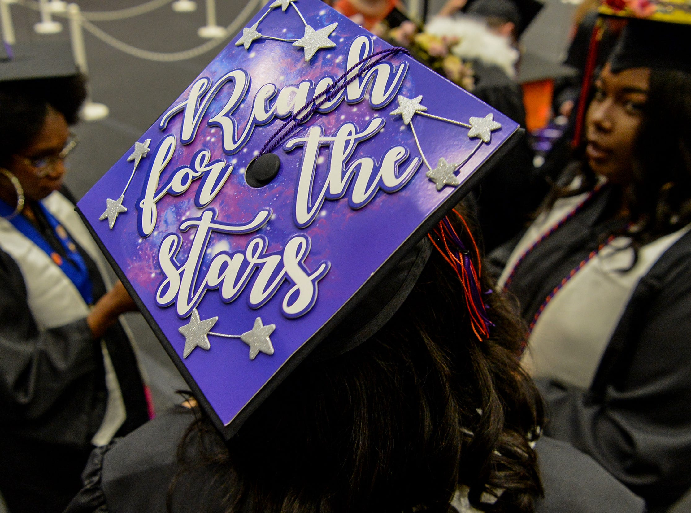 """Natasha Brigmon wears a cap with """"Reach for the stars"""" written on it during Clemson University commencement ceremonies in Littlejohn Coliseum in Clemson Friday, May 10, 2019."""