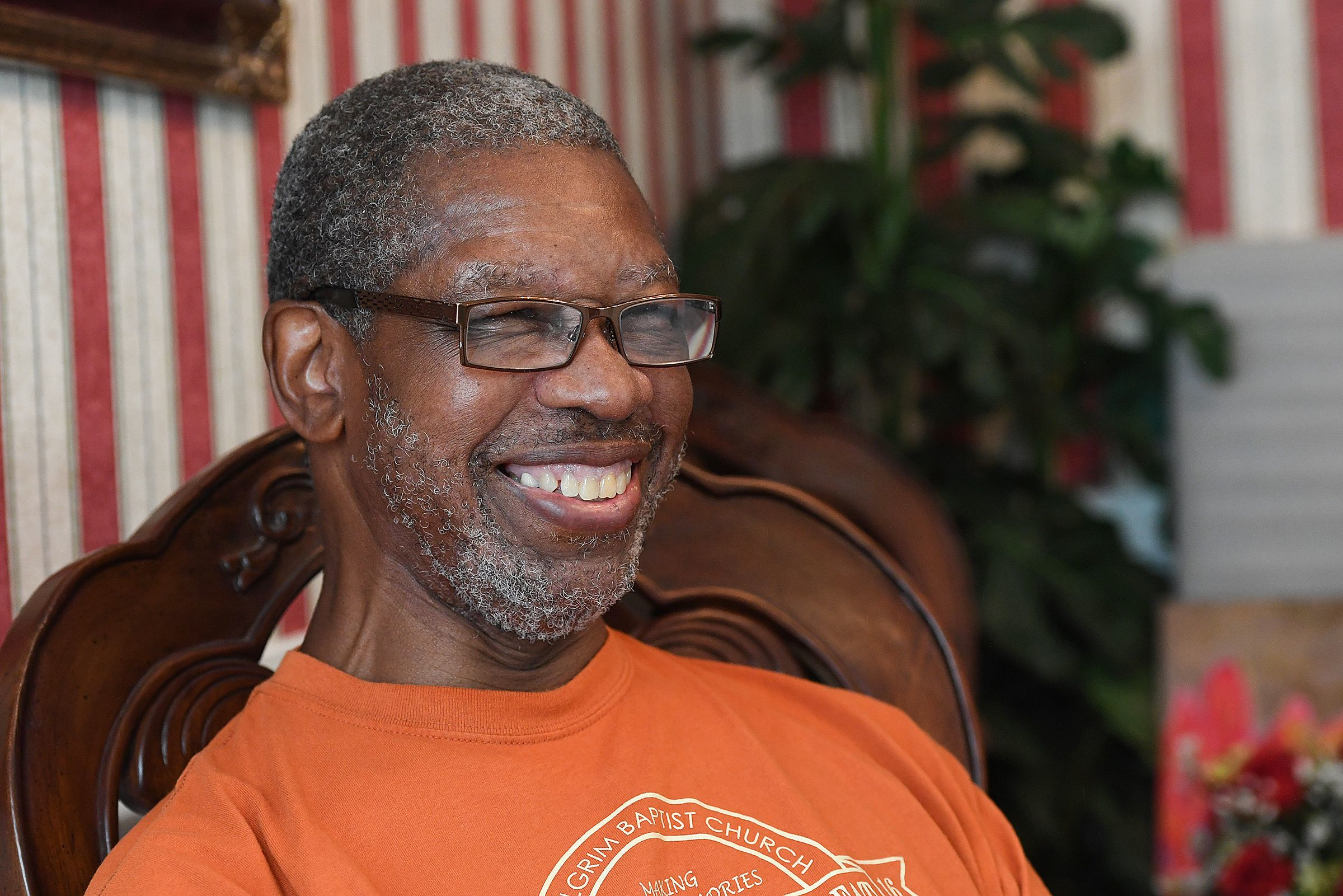 Hall of Fame cross country and track coach Willie Wooden, who was diagnosed with ALS in August 2017, laughs during an interview at his home in Simpsonville July 25.