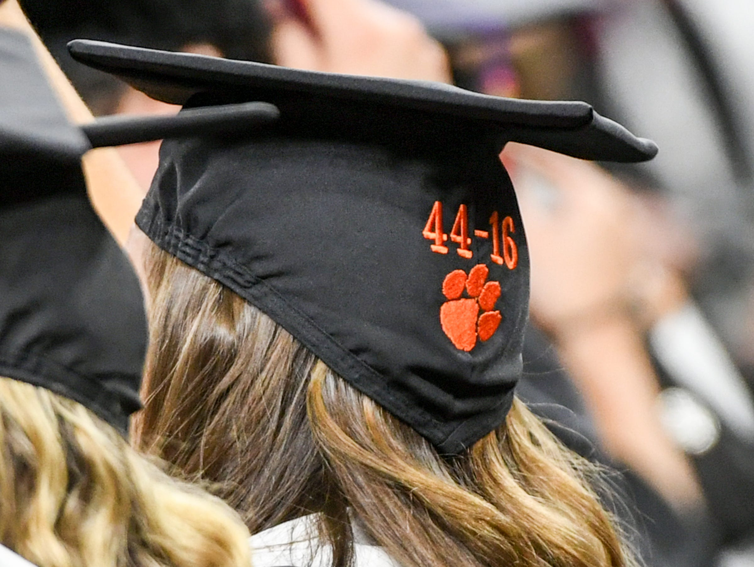 A graduate wears a cap with 44-16 embroidered in it during Clemson University commencement ceremonies in Littlejohn Coliseum in Clemson Friday, May 10, 2019. Clemson football beat Alabama in January 44-16 for their second football national championship in three years.