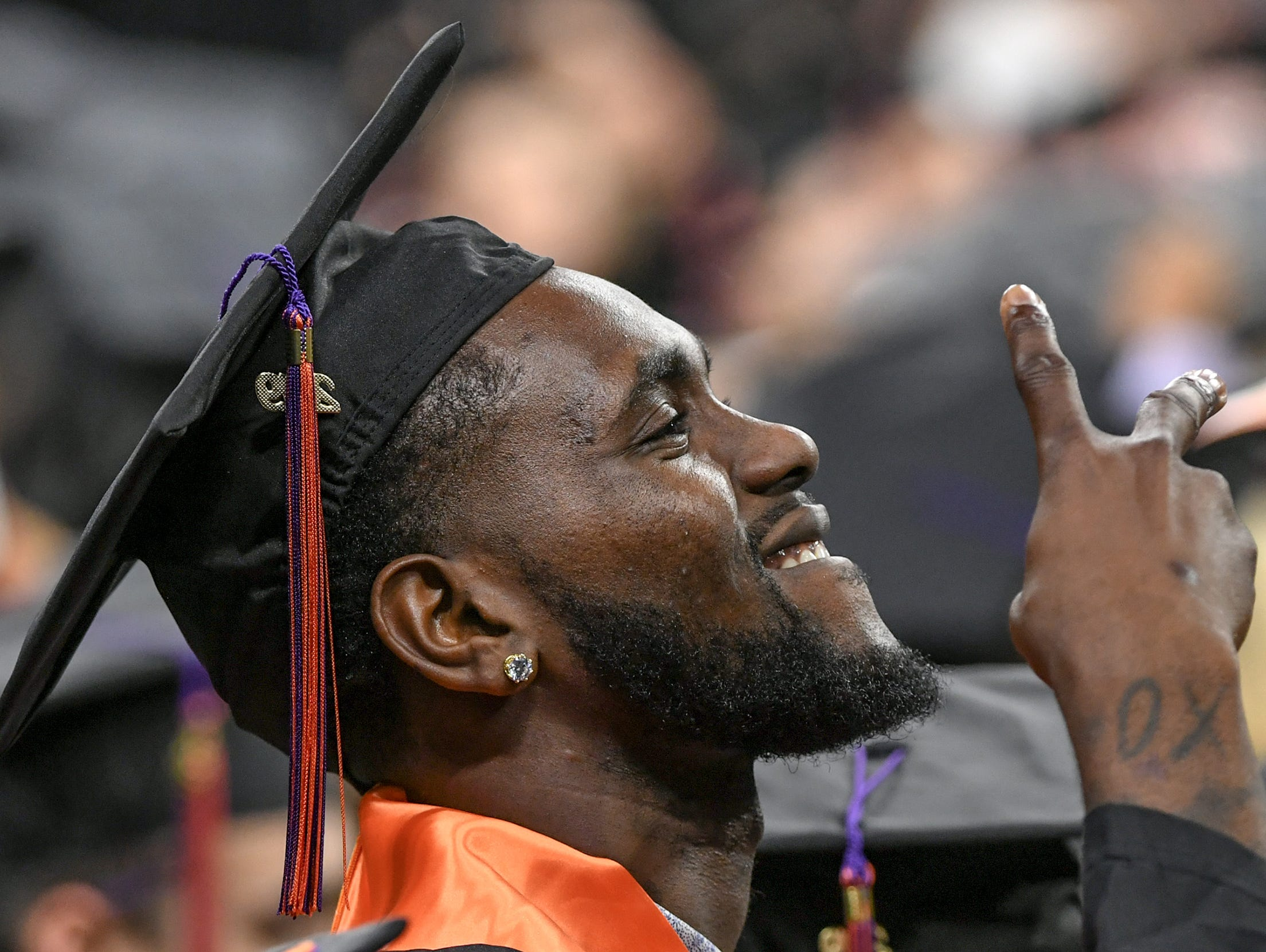 Former men's basketball player Elijah Thomas of Dallas, Texas celebrates during Clemson University commencement ceremonies in Littlejohn Coliseum in Clemson Friday, May 10, 2019. Thomas earned a bachelor of science in Parks, Recreation, and Tourism Management.